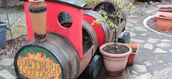 We saw quite a few of these garden decorations/planters made of old casks and thought they were pretty  awesome.